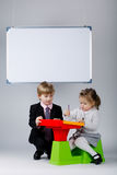 Young boy teaching sister Royalty Free Stock Photo
