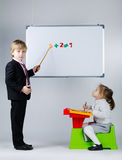 Young boy teaching sister Royalty Free Stock Images