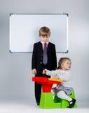 Young boy teaching sister Stock Photos