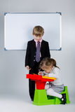 Young boy teaching sister Stock Photo