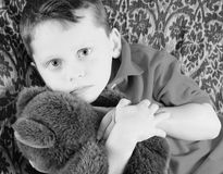 Young boy and teddybear Stock Image