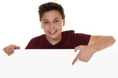 Young boy or teenager showing empty banner with copy space Royalty Free Stock Photography