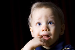 Young boy teething royalty free stock photography