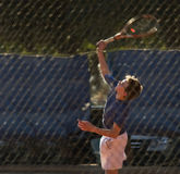 Young boy in tennis match. Ball hitting wing Stock Images