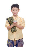 Young boy in Thai traditional dress holding water cup Royalty Free Stock Images