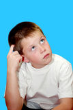 Young boy thinking stock photo