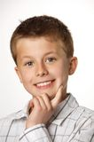 Young boy thinking Royalty Free Stock Image