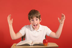 Young boy thinking desk &hands Stock Photos