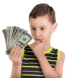 Young boy thinking what to buy with money Royalty Free Stock Photos