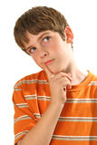 Young boy thinking on white - vertical. Shot of young boy thinking on white - vertical stock image