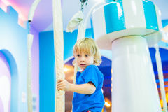 Young boy thrilled on the carousel ride Stock Images