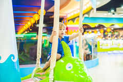 Young boy thrilled on the carousel ride Stock Image