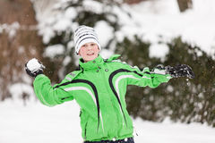 Young boy throwing snowballs Stock Photo