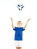 Young boy throwing soccer ball Royalty Free Stock Image