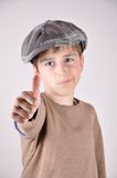 Young boy with a thumb up. Young boy with a newsboy cap showing a thumb up Royalty Free Stock Photo