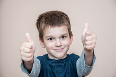 Young boy with thumbs up royalty free stock photos