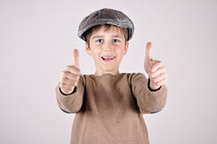 Young boy with thumbs up. Young boy with a newsboy cap showing thumbs up Royalty Free Stock Photo