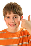 Young boy thumbs up vertical. Shot of young boy thumbs up royalty free stock photography