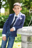 Young boy with tie smiling stock photo