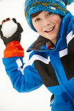 Young Boy About To Throw Snowball Stock Photo