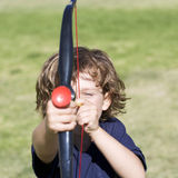 A young boy with a toy bow and arrow Stock Images