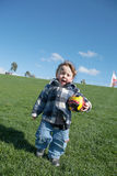 Young boy with toy soccer ball Stock Image