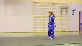 Young boy in yifu clothes for tai chi training nanquan exercise in sport club. Young boy in traditional blue yifu clothes for tai chi training nanquan exercise stock video