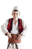 Young boy in traditional clothing holding band Stock Photos