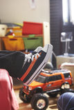 Young boy trainers on bed Stock Images