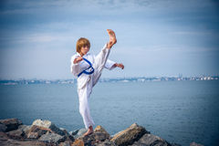 Young boy training karate Stock Photo