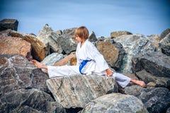 Young boy training karate Stock Photos