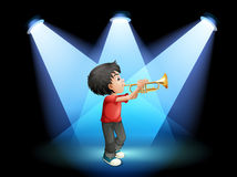 A young boy with a trumpet at the stage Stock Photo