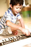 Young boy trying out a keyboard Royalty Free Stock Image