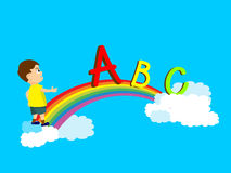 Young boy trying to cross a rainbow Royalty Free Stock Images