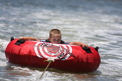 Young boy tubing. A young boy tubing in the waterway royalty free stock photography