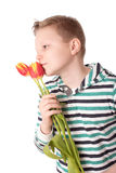 Young boy with tulips  on white background Royalty Free Stock Image