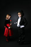 Young boy in tux in foreground Royalty Free Stock Photos