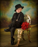Young boy in tuxedo 3. Little boy in tuxedo with bouquet of roses Stock Photos