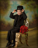 Young boy in tuxedo 4. Little boy in tuxedo with bouquet of roses Royalty Free Stock Images