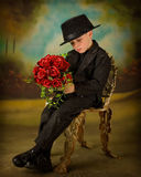 Young boy in tuxedo 5. Little boy in tuxedo with bouquet of roses Royalty Free Stock Images