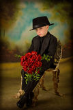 Young boy in tuxedo 6. Little boy in tuxedo with bouquet of roses Stock Image