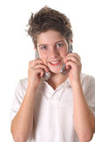 Young boy on two cell phone vertical. Shot of a young boy on two cell phone vertical Stock Photo