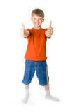 Young boy with two thumbs up. On a white background stock photography
