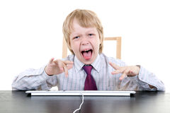 Young boy typing Stock Photos