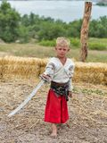 Young boy Ukrainian Cossack in Zaporozhian Sich. Khortytsia island, Ukraine stock photography