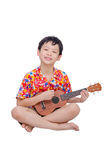 Young boy with ukulele over white. Young Asian boy with ukulele over white background Royalty Free Stock Image