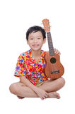 Young boy with ukulele over white. Young Asian boy with ukulele over white background Stock Photography