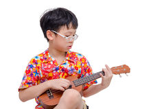 Young boy with ukulele over white. Young Asian boy with ukulele over white background Royalty Free Stock Photo