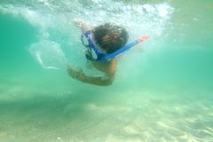 Young boy underwater in sea Stock Images