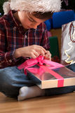 Young boy unpacking present Stock Image